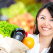 Woman grocery shopping Woman grocery shopping — Stock Photo #16567223