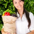 Woman buying fresh food Woman buying fresh food — Stock Photo #16567235