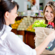 Woman at the markets checkout Woman at the markets checkout — Stock Photo #16567287