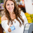 Woman at the checkout Woman at the checkout — Stock Photo #16567341