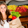 Woman grocery shopping Woman grocery shopping — Stock Photo #16567423