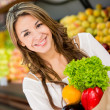 Stock Photo: Wombuying groceries Wombuying groceries