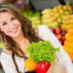 Woman at the supermarket Woman at the supermarket — Stock Photo #16567525