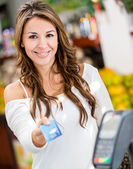 Woman at the checkout Woman at the checkout — Stock Photo