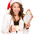Woman opening a Christmas gift Woman opening a Christmas gift — Stock Photo