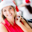 Happy woman Shopping for Christmas Happy woman Shopping for Christmas - Stock Photo