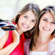 Stock Photo: Beautiful female shoppers Beautiful female shoppers