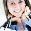 Happy female shopper Happy female shopper - Stock Photo
