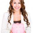Stock Photo: Businesswomsaving money Businesswomsaving money