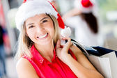Happy woman Shopping for Christmas Happy woman Shopping for Christmas — Stock Photo