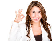 Businesswoman making an ok sign Businesswoman making an ok sign — Stock Photo