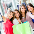 Stock Photo: Excited female shoppers Excited female shoppers