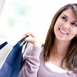 Pensive shopping woman Pensive shopping woman - Stock Photo