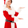 Female Santa displaying something Female Santa displaying something — Stock Photo #16963113
