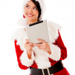Thoughtful Mrs Claus with tablet Thoughtful Mrs Claus with tablet — Stock Photo #16963125