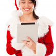 Female Santa with a tablet computer Female Santa with a tablet computer — Stock Photo