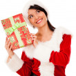 Female Santa with a gift Female Santa with a gift — Stock Photo