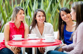 Women talking over coffee Women talking over coffee — Stock Photo