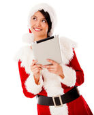 Thoughtful Mrs Claus with a tablet Thoughtful Mrs Claus with a tablet — Stock Photo
