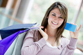 Female shopper with credit card Female shopper with credit card — Stock Photo
