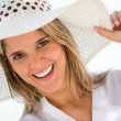 Woman wearing a summer hat Woman wearing a summer hat — Stock Photo