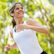 Stockfoto: Woman jogging outdoors Woman jogging outdoors