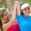Woman with her fitness trainer Woman with her fitness trainer — Stock Photo #18948835