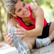 Foto Stock: Athletic woman stretching Athletic woman stretching