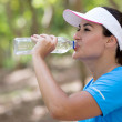 Stock Photo: Sportive womdrinking water Sportive womdrinking water