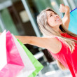 Excited shopping woman Excited shopping woman — Stock Photo