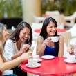 Stock Photo: Girl friends meeting for coffee Girl friends meeting for coffee