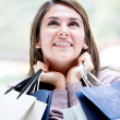 Thoughtful female shopper Thoughtful female shopper — Stock Photo