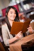 Woman looking at the menu Woman looking at the menu — Stock Photo