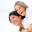 Happy couple laughing outdoors Happy couple laughing outdoors - Stockfoto