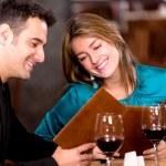 Romantic couple at a restaurant Romantic couple at a restaurant — Stock Photo