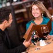 Stock Photo: Couple eating at a restaurant Couple eating at a restaurant