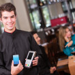 Waiter holding a dataphone Waiter holding a dataphone — Stock Photo