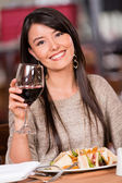 Beautiful woman at a restaurant Beautiful woman at a restaurant — Stock Photo