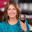 Stock Photo: Woman having a glass of wine Woman having a glass of wine
