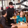 Couple eating at a restaurant - Foto Stock