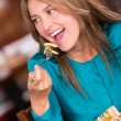 Happy woman eating Happy woman eating — Stock Photo