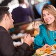 Friends eating at a restaurant Friends eating at a restaurant — Stock Photo