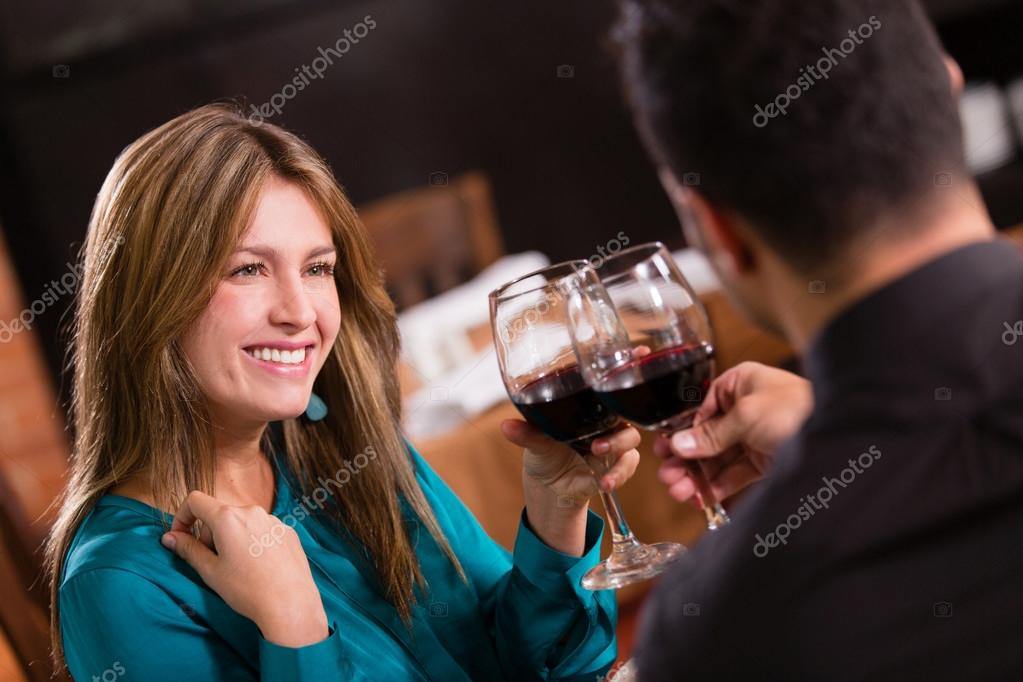Beautiful couple on a date toasting and looking happy Beautiful couple on a date toasting and looking happy  — Stock Photo #19192627