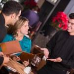 Waiter explaining the menu Waiter explaining the menu — Stock Photo