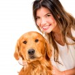 Happy woman with a dog Happy woman with a dog — Stock Photo #19632487