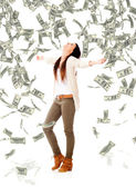 Woman under a money rain Woman under a money rain — Stockfoto