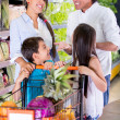 Royalty-Free Stock Photo: Family at the supermarket Family at the supermarket