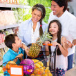 Stock Photo: Happy family at supermarket Happy family at supermarket