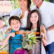 Happy family at the grocery store Happy family at the grocery store — Stock Photo #19836763