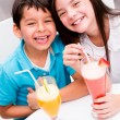 Kids drinking juice and smiling Kids drinking juice and smiling — Stock Photo #19836775